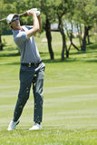 Nicolas Colsaerts. Clubbing the ball up the fairway, to the pin Royalty Free Stock Photo