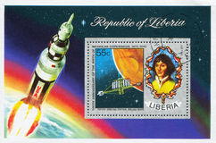 Nicolaus Copernicus and concept of orbiting station around Mars. LIBERIA - CIRCA 1973: stamp printed by Liberia, shows Nicolaus Copernicus and concept of Stock Images