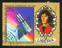Nicolaus Copernicus and Orbiting astronomical observatory. LIBERIA - CIRCA 1973: stamp printed by Liberia, shows Nicolaus Copernicus and Orbiting astronomical Stock Photo