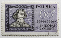 Nicolaus Copernicus on a vintage post stamp. Nicolaus Copernicus on a vintage, canceled,  post stamp from Poland Royalty Free Stock Photos