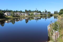 The Nicomekl River in Surrey, British Columbia. A view looking west near the mouth of the Nicomekl River in South Surrey, British Columbia Stock Image