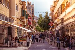 NICOSIA - APRIL 13 : People walking on Ledra street on April 13, 2015 in Nicosia, Cyprus. It is is a major shopping thoroughfare i Royalty Free Stock Image