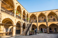 NICOSIA, CYPRUS - AUGUST 10, 2015: Buyuk Han (The Great Inn) a touristic center with an antique souvenir shops, craft workshops an Stock Photography