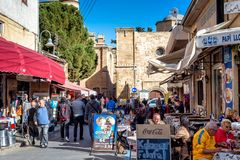 NICOSIA, CYPRUS - DECEMBER 03, 2015: Cafes and restaurants at Ar. Asta street, a touristic street leading to an Selimiye mosque Royalty Free Stock Photo