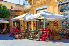 NICOSIA, CYPRUS - DECEMBER 3: Old fashioned cafe terrace at Fanairomenis street on December 3, 2015 in Nicosia Stock Photography