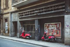 NICOSIA, CYPRUS - FEBRUARY 20, 2017: Old cinema and red moped in Nicosia, Cyprus stock photos
