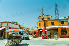 NICOSIA, NORTHERN CYPRUS- MAY 30, 2014 : View on the part of local market, truck with flowers  and small shops in Nicosia. Royalty Free Stock Photos