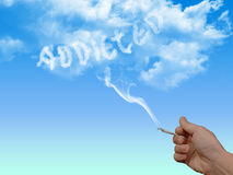 Nicotine addict with addicted written in clouds Stock Photos