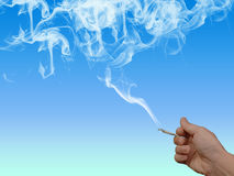 Nicotine addict with skull in smoke Stock Photography