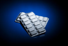 Nicotine gum. 2 packages of nicotine gum on dark blue background stock photos