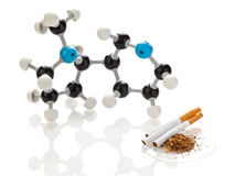 Nicotine molecule with tobacco and cigarettes Royalty Free Stock Photos