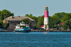 Nida ferry boat and lighthouse in Baltiysk. Russia Stock Photo