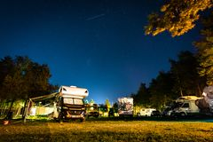 Nida, Lithuania, August 2018: RVs and motorhomes on the campgaoung Nidos kempingas in Nida. Nida is a resort town in stock photography