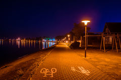 Nida in Lithuania. Night scene lights and reflections Stock Image