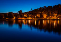 Nida in Lithuania. Night scene lights and reflections Royalty Free Stock Image