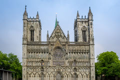 Nidarosdomen cathedral towers in Trondheim, Norway. Nidaros ancient gothic cathedral front view from city central square. Nidarosdomen, Trondheim, Norway stock images