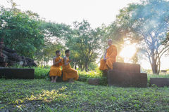 Nidentified Thai monks in the garden at Phanomwan Historical Par Stock Photo