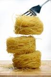 Nidi della pasta dei vermicelli Fotografie Stock