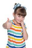 Nieśmiała mała dziewczynka trzyma jej aprobaty Obraz Royalty Free