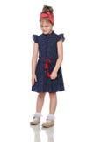 Nieśmiała mała dziewczynka w błękitnej sukni Zdjęcie Stock