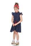 Nieśmiała mała dziewczynka w błękitnej sukni zdjęcia stock