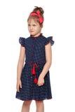 Nieśmiała mała dziewczynka w błękitnej sukni Zdjęcie Royalty Free