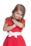 Nieśmiała mała dziewczynka w czerwonej sukni obraz stock