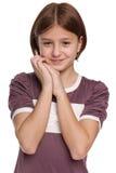 Nieśmiała preteen dziewczyna na bielu Fotografia Royalty Free