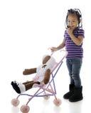 Nieśmiały Preschooler z Jej lalą fotografia stock