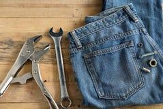 Niebiescy Dżinsy i narzędzia Fotografia Stock