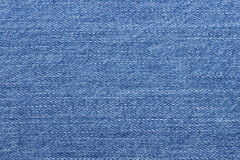 Niebiescy dżinsy jako tło Obrazy Royalty Free