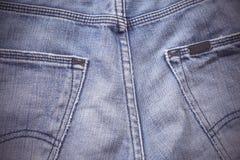 Niebiescy dżinsy popierają kieszeni tło Zdjęcie Stock