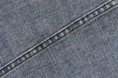 Niebiescy dżinsy sukienna tekstura z ściegiem Zdjęcia Royalty Free