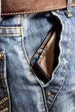 Niebiescy dżinsy trouser z portflem obraz royalty free