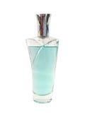 niebieska tła butelka perfum w white Zdjęcie Royalty Free