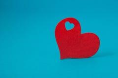 niebieska tła czerwony serca Fotografia Royalty Free