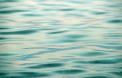 niebieski metalicznego wody Fotografia Royalty Free
