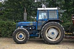 niebieski stary ciągnika Zdjęcia Stock