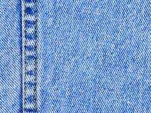 niebieskie dżinsy drelichowi materialne Fotografia Stock