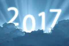 Niebieskie niebo i chmury z teksta sunbeam nowego roku 2017 szczęśliwym concep Obrazy Royalty Free