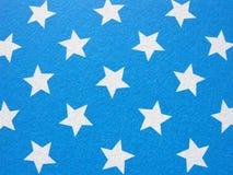 niebieskie oczy, piaskowe tło kolorowy papier Dzieci tapetowi Zdjęcia Stock