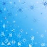 niebieskie tło gwiazdkę płatki śniegu Fotografia Stock