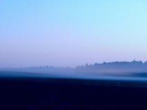 Niebla. Amanecer. Fotos de archivo libres de regalías