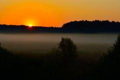 Niebla en la puesta del sol Imágenes de archivo libres de regalías