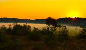 Niebla en la puesta del sol Fotos de archivo libres de regalías