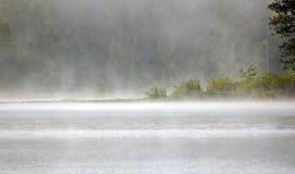 Niebla sobre el lago Fotografía de archivo libre de regalías
