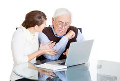 Niece teaching grandfather use laptop Royalty Free Stock Photo