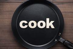 Niecka z słowo kucharzem Zdjęcie Royalty Free