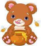 Niedźwiadkowych chwytów Miodowy słój Zdjęcia Stock