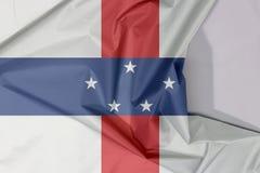 Niederländische Antillen-Gewebeflaggenkrepp und -falte mit Leerraum lizenzfreies stockbild